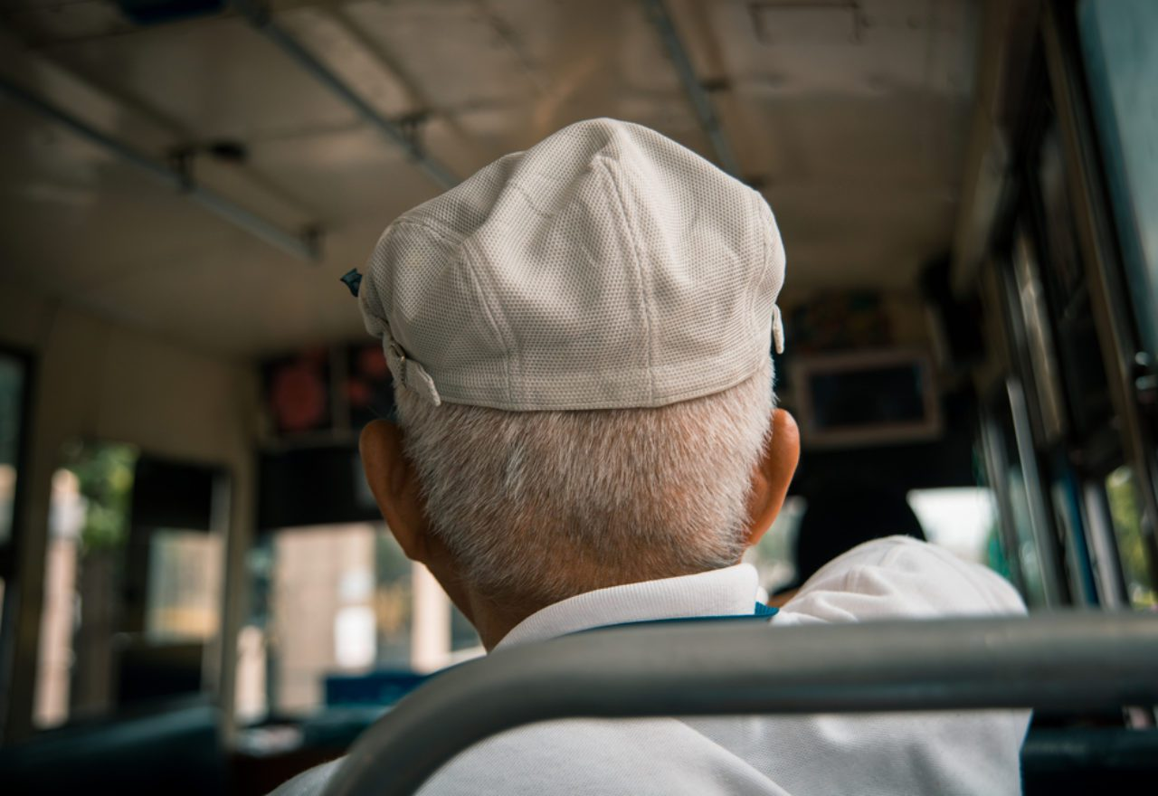 old man on bus